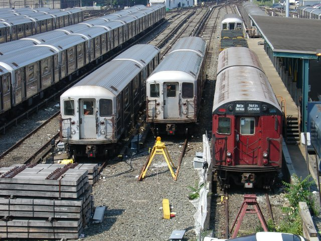 (126k, 640x480)<br><b>Country:</b> United States<br><b>City:</b> New York<br><b>System:</b> New York City Transit<br><b>Location:</b> Corona Yard<br><b>Photo by:</b> Kevin Lee<br><b>Date:</b> 6/9/2005<br><b>Notes:</b> Redbird sharing space with R-62's in the Corona Yard.<br><b>Viewed (this week/total):</b> 2 / 2399