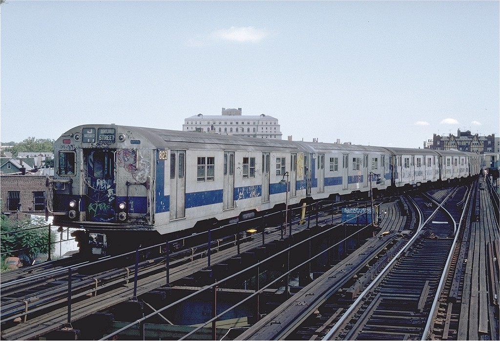 (240k, 1024x699)<br><b>Country:</b> United States<br><b>City:</b> New York<br><b>System:</b> New York City Transit<br><b>Line:</b> BMT Nassau Street/Jamaica Line<br><b>Location:</b> Queens Boulevard (Demolished) <br><b>Route:</b> J<br><b>Car:</b> R-27 (St. Louis, 1960)  8123 <br><b>Photo by:</b> Steve Zabel<br><b>Collection of:</b> Joe Testagrose<br><b>Date:</b> 8/18/1982<br><b>Viewed (this week/total):</b> 17 / 4502