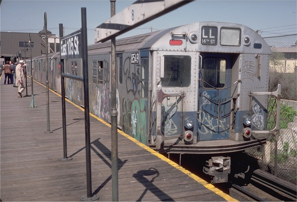 (220k, 1024x695)<br><b>Country:</b> United States<br><b>City:</b> New York<br><b>System:</b> New York City Transit<br><b>Line:</b> BMT Canarsie Line<br><b>Location:</b> East 105th Street <br><b>Route:</b> LL<br><b>Car:</b> R-30 (St. Louis, 1961) 8549 <br><b>Photo by:</b> Steve Zabel<br><b>Collection of:</b> Joe Testagrose<br><b>Date:</b> 4/30/1977<br><b>Viewed (this week/total):</b> 1 / 3430