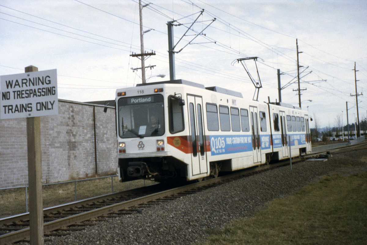 (184k, 1044x705)<br><b>Country:</b> United States<br><b>City:</b> Portland, OR<br><b>System:</b> Portland MAX<br><b>Line:</b> MAX Blue (East-West) Line<br><b>Car:</b> MAX Type 1 (Bombardier)  118 <br><b>Photo by:</b> Ed Davis, Sr.<br><b>Collection of:</b> David Pirmann<br><b>Date:</b> 2/1991<br><b>Viewed (this week/total):</b> 1 / 1990