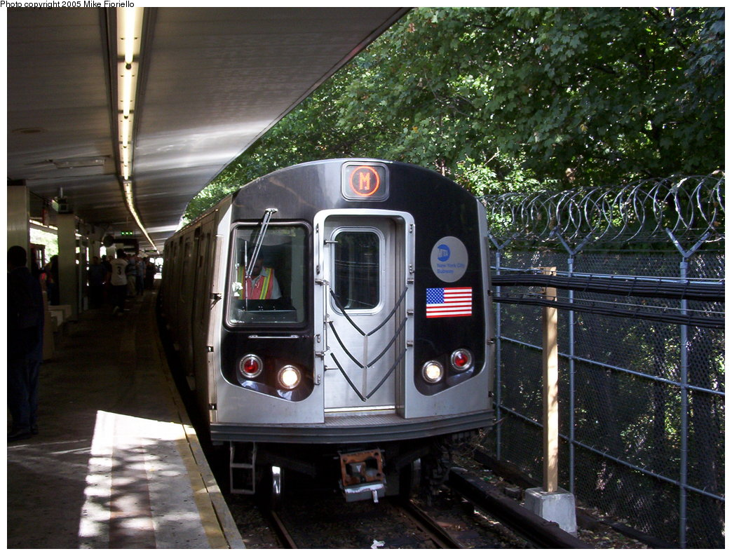 (221k, 1044x793)<br><b>Country:</b> United States<br><b>City:</b> New York<br><b>System:</b> New York City Transit<br><b>Line:</b> BMT Myrtle Avenue Line<br><b>Location:</b> Metropolitan Avenue <br><b>Route:</b> M<br><b>Car:</b> R-143 (Kawasaki, 2001-2002)  <br><b>Photo by:</b> Mike Fioriello<br><b>Date:</b> 9/27/2003<br><b>Viewed (this week/total):</b> 0 / 3738