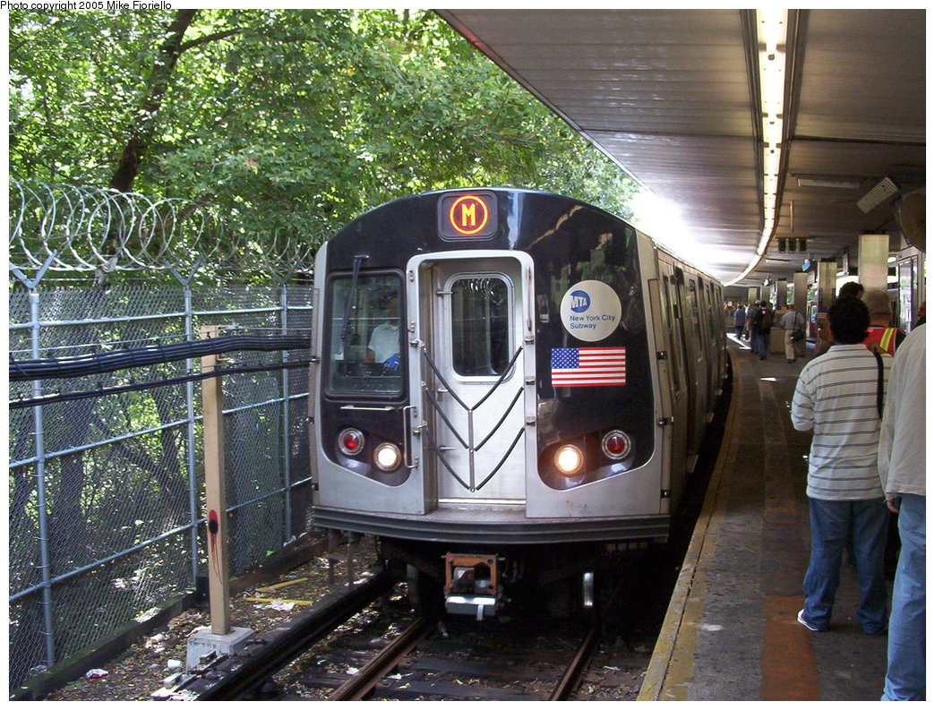 (281k, 1044x793)<br><b>Country:</b> United States<br><b>City:</b> New York<br><b>System:</b> New York City Transit<br><b>Line:</b> BMT Myrtle Avenue Line<br><b>Location:</b> Metropolitan Avenue <br><b>Route:</b> M<br><b>Car:</b> R-143 (Kawasaki, 2001-2002)  <br><b>Photo by:</b> Mike Fioriello<br><b>Date:</b> 9/27/2003<br><b>Viewed (this week/total):</b> 0 / 4489