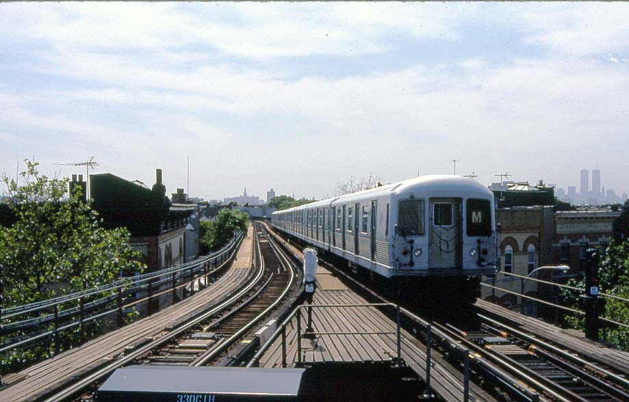 (101k, 919x588)<br><b>Country:</b> United States<br><b>City:</b> New York<br><b>System:</b> New York City Transit<br><b>Line:</b> BMT Myrtle Avenue Line<br><b>Location:</b> Forest Avenue <br><b>Route:</b> M<br><b>Car:</b> R-42 (St. Louis, 1969-1970)   <br><b>Photo by:</b> Christopher Sattler<br><b>Date:</b> 6/16/1994<br><b>Viewed (this week/total):</b> 1 / 11677