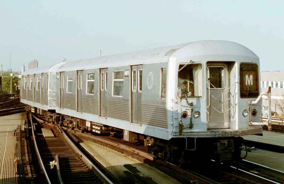 (42k, 988x640)<br><b>Country:</b> United States<br><b>City:</b> New York<br><b>System:</b> New York City Transit<br><b>Location:</b> Coney Island/Stillwell Avenue<br><b>Route:</b> M<br><b>Car:</b> R-42 (St. Louis, 1969-1970)  4911 <br><b>Photo by:</b> Michael Pompili<br><b>Date:</b> 10/23/2001<br><b>Viewed (this week/total):</b> 2 / 2261