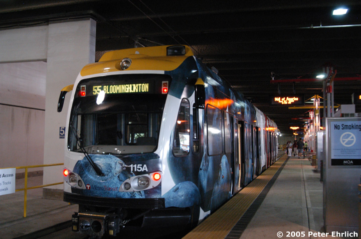 (138k, 720x478)<br><b>Country:</b> United States<br><b>City:</b> Minneapolis, MN<br><b>System:</b> MNDOT Light Rail Transit<br><b>Line:</b> Hiawatha Line<br><b>Location:</b> <b><u>Mall of America </b></u><br><b>Car:</b> Bombardier Flexity Swift  115 <br><b>Photo by:</b> Peter Ehrlich<br><b>Date:</b> 8/27/2005<br><b>Notes:</b> The Mall Of America terminal is located under the parking garage. Like many other cash-strapped transit agencies, MetroTransit has resorted to shrinkwrapping adverts on many of its LRVs.<br><b>Viewed (this week/total):</b> 0 / 2734