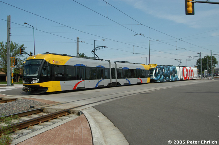 (121k, 720x478)<br><b>Country:</b> United States<br><b>City:</b> Minneapolis, MN<br><b>System:</b> MNDOT Light Rail Transit<br><b>Line:</b> Hiawatha Line<br><b>Location:</b> <b><u>28th Ave. </b></u><br><b>Car:</b> Bombardier Flexity Swift  104+115 <br><b>Photo by:</b> Peter Ehrlich<br><b>Date:</b> 9/4/2005<br><b>Notes:</b> Outbound train at the 28th Avenue/82nd Street intersection just beyond 28th Avenue Station.<br><b>Viewed (this week/total):</b> 2 / 1265