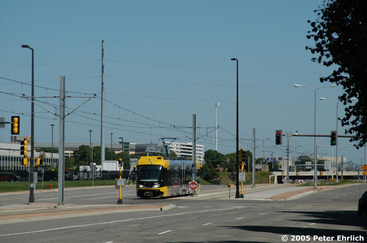 (116k, 720x478)<br><b>Country:</b> United States<br><b>City:</b> Minneapolis, MN<br><b>System:</b> MNDOT Light Rail Transit<br><b>Line:</b> Hiawatha Line<br><b>Location:</b> 34th Avenue/American Blvd. <br><b>Car:</b> Bombardier Flexity Swift  105 <br><b>Photo by:</b> Peter Ehrlich<br><b>Date:</b> 8/28/2005<br><b>Notes:</b> LRVs at 34th Avenue/American Blvd. outbound.<br><b>Viewed (this week/total):</b> 0 / 1084