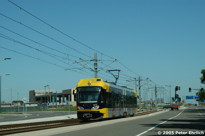 (106k, 720x478)<br><b>Country:</b> United States<br><b>City:</b> Minneapolis, MN<br><b>System:</b> MNDOT Light Rail Transit<br><b>Line:</b> Hiawatha Line<br><b>Location:</b> 34th Avenue/nr. Ft. Snelling National Cem. <br><b>Car:</b> Bombardier Flexity Swift  107 <br><b>Photo by:</b> Peter Ehrlich<br><b>Date:</b> 8/28/2005<br><b>Notes:</b> Car 107 heading inbound along 34th Avenue. The Ft. Snelling National Cemetery is out of the picture on the right.<br><b>Viewed (this week/total):</b> 3 / 1036