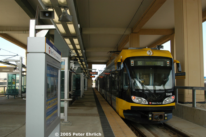 (127k, 720x478)<br><b>Country:</b> United States<br><b>City:</b> Minneapolis, MN<br><b>System:</b> MNDOT Light Rail Transit<br><b>Line:</b> Hiawatha Line<br><b>Location:</b> <b><u>Airport-Humphrey Terminal </b></u><br><b>Car:</b> Bombardier Flexity Swift  104+115 <br><b>Photo by:</b> Peter Ehrlich<br><b>Date:</b> 9/4/2005<br><b>Notes:</b> Inbound train at Humphrey Terminal Station.  Charter flights operate from this terminal.<br><b>Viewed (this week/total):</b> 2 / 1472