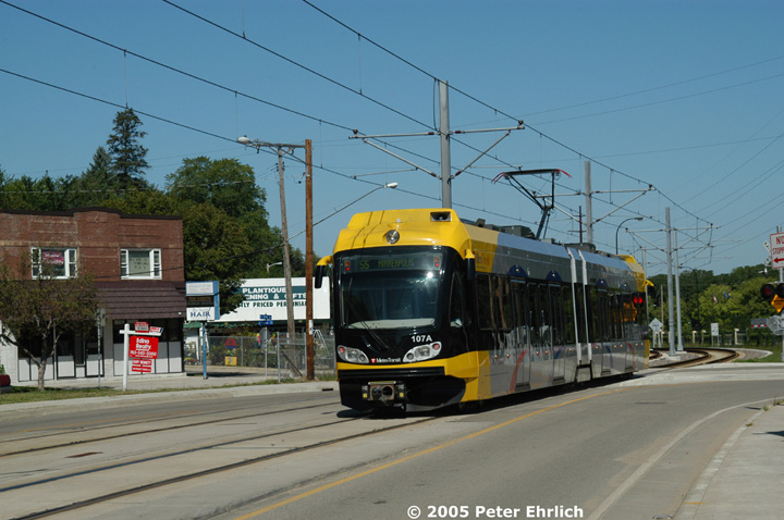 (137k, 720x478)<br><b>Country:</b> United States<br><b>City:</b> Minneapolis, MN<br><b>System:</b> MNDOT Light Rail Transit<br><b>Line:</b> Hiawatha Line<br><b>Location:</b> Minnehaha Avenue/52nd Street <br><b>Car:</b> Bombardier Flexity Swift  107 <br><b>Photo by:</b> Peter Ehrlich<br><b>Date:</b> 8/28/2005<br><b>Notes:</b> Inbound train at Minnehaha Avenue/52nd Street.<br><b>Viewed (this week/total):</b> 6 / 1750