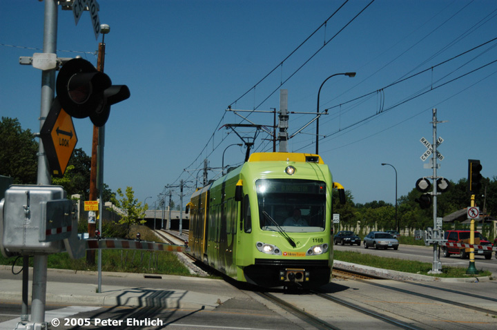 (133k, 720x478)<br><b>Country:</b> United States<br><b>City:</b> Minneapolis, MN<br><b>System:</b> MNDOT Light Rail Transit<br><b>Line:</b> Hiawatha Line<br><b>Location:</b> <b><u>50th Street/Minnehaha Park </b></u><br><b>Car:</b> Bombardier Flexity Swift  116 <br><b>Photo by:</b> Peter Ehrlich<br><b>Date:</b> 8/27/2005<br><b>Notes:</b> iPod-wrapped train approaching 50th Street/Minnehaha Park Station outbound.<br><b>Viewed (this week/total):</b> 0 / 1192
