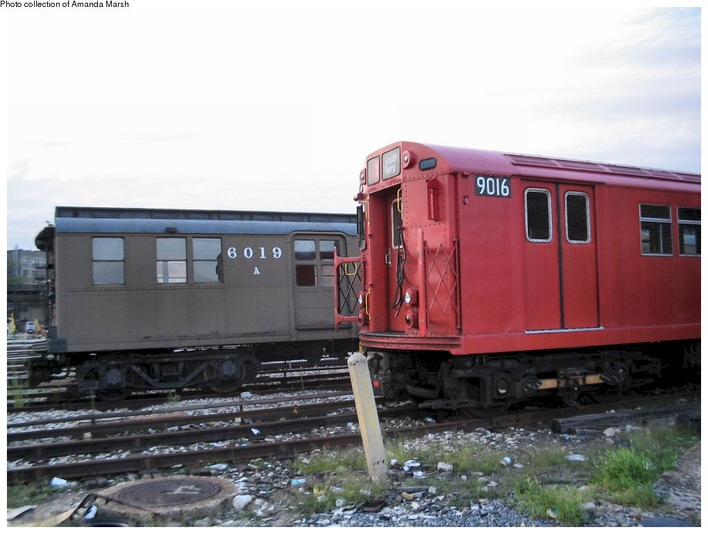 (127k, 1020x770)<br><b>Country:</b> United States<br><b>City:</b> New York<br><b>System:</b> New York City Transit<br><b>Location:</b> 207th Street Yard<br><b>Car:</b> BMT D-Type Triplex 6019 <br><b>Collection of:</b> Amanda Marsh<br><b>Date:</b> 7/25/2004<br><b>Notes:</b> With R33 9016.<br><b>Viewed (this week/total):</b> 4 / 1924
