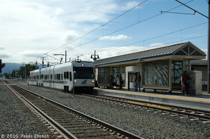 (163k, 720x478)<br><b>Country:</b> United States<br><b>City:</b> San Jose, CA<br><b>System:</b> Santa Clara VTA<br><b>Line:</b> VTA Vasona Line<br><b>Location:</b> Bascom <br><b>Car:</b> VTA Kinki-Sharyo 999+998 <br><b>Photo by:</b> Peter Ehrlich<br><b>Date:</b> 10/1/2005<br><b>Notes:</b> 999+998 arriving Bascom Station inbound.<br><b>Viewed (this week/total):</b> 3 / 1037