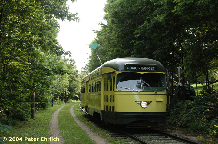 (204k, 720x478)<br><b>Country:</b> United States<br><b>City:</b> Minneapolis, MN<br><b>System:</b> Minnesota Streetcar Museum <br><b>Line:</b> Como-Harriet Line<br><b>Car:</b>  322 <br><b>Photo by:</b> Peter Ehrlich<br><b>Date:</b> 8/1/2004<br><b>Notes:</b> PCC 322 approaching Carbarn.<br><b>Viewed (this week/total):</b> 2 / 1252