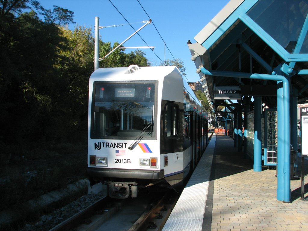 (156k, 1024x768)<br><b>Country:</b> United States<br><b>City:</b> Weehawken, NJ<br><b>System:</b> Hudson Bergen Light Rail<br><b>Location:</b> Port Imperial <br><b>Car:</b> NJT-HBLR LRV (Kinki-Sharyo, 1998-99)  2013 <br><b>Photo by:</b> Brian Weinberg<br><b>Date:</b> 10/30/2005<br><b>Notes:</b> NJT HBLR LRV 2013B @ Port Imperial (second day of service).<br><b>Viewed (this week/total):</b> 2 / 1817