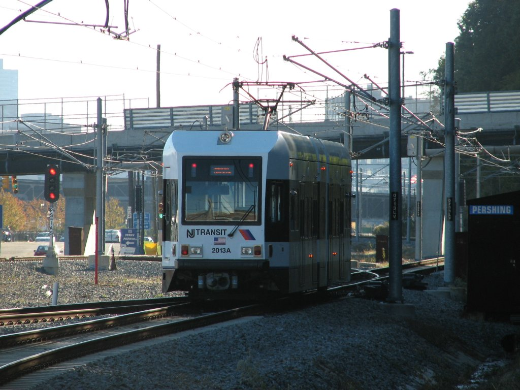 (160k, 1024x768)<br><b>Country:</b> United States<br><b>City:</b> Weehawken, NJ<br><b>System:</b> Hudson Bergen Light Rail<br><b>Location:</b> Port Imperial <br><b>Car:</b> NJT-HBLR LRV (Kinki-Sharyo, 1998-99)  2013 <br><b>Photo by:</b> Brian Weinberg<br><b>Date:</b> 10/30/2005<br><b>Notes:</b> NJT HBLR LRV 2013A @ Port Imperial (second day of service).<br><b>Viewed (this week/total):</b> 1 / 1797