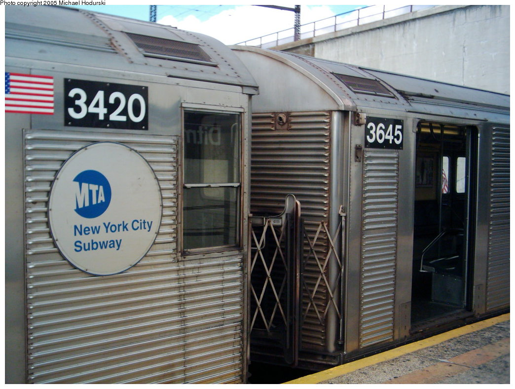 (192k, 1044x788)<br><b>Country:</b> United States<br><b>City:</b> New York<br><b>System:</b> New York City Transit<br><b>Line:</b> BMT Astoria Line<br><b>Location:</b> Ditmars Boulevard <br><b>Route:</b> N<br><b>Car:</b> R-32 (Budd, 1964)  3420 <br><b>Photo by:</b> Michael Hodurski<br><b>Date:</b> 7/2005<br><b>Notes:</b> R32 3420 mismatched with 3645.<br><b>Viewed (this week/total):</b> 0 / 3109