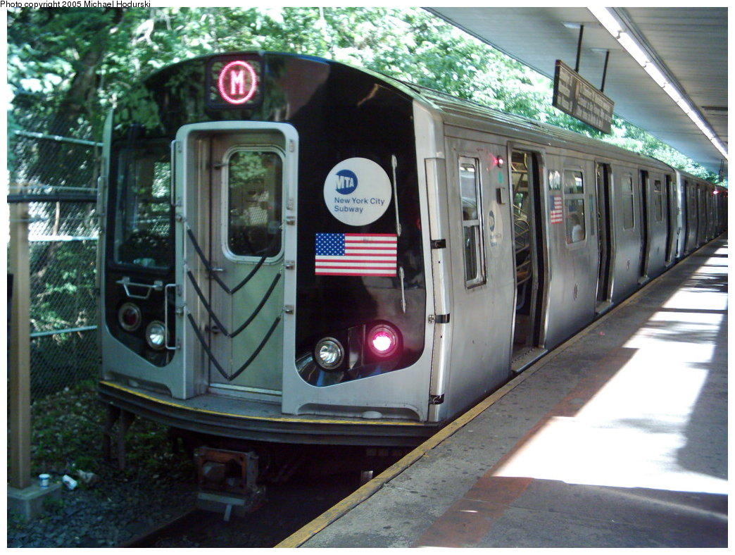 (203k, 1044x788)<br><b>Country:</b> United States<br><b>City:</b> New York<br><b>System:</b> New York City Transit<br><b>Line:</b> BMT Myrtle Avenue Line<br><b>Location:</b> Metropolitan Avenue <br><b>Car:</b> R-143 (Kawasaki, 2001-2002)  <br><b>Photo by:</b> Michael Hodurski<br><b>Date:</b> 8/10/2005<br><b>Notes:</b> Weekend Myrtle shuttle.<br><b>Viewed (this week/total):</b> 0 / 4548