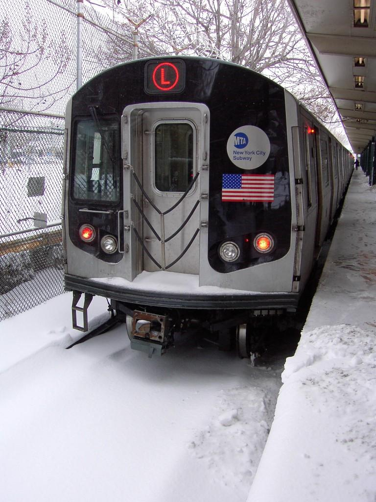 (144k, 768x1024)<br><b>Country:</b> United States<br><b>City:</b> New York<br><b>System:</b> New York City Transit<br><b>Line:</b> BMT Canarsie Line<br><b>Location:</b> Rockaway Parkway <br><b>Route:</b> L<br><b>Car:</b> R-143 (Kawasaki, 2001-2002)  <br><b>Photo by:</b> Brian Weinberg<br><b>Date:</b> 2/17/2003<br><b>Notes:</b> Snow covered tracks - Presidents' Day Blizzard 2003.<br><b>Viewed (this week/total):</b> 2 / 6497