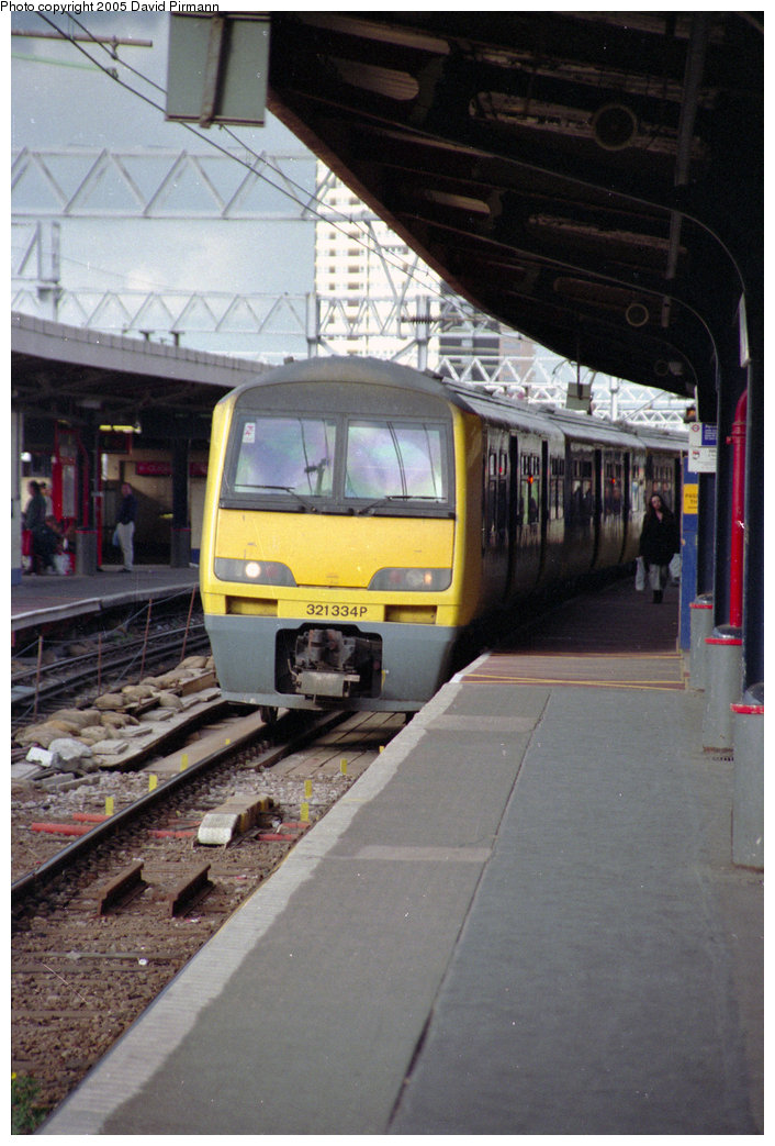 (190k, 706x1043)<br><b>Country:</b> United Kingdom<br><b>City:</b> London<br><b>System:</b> London Main Line Rail<br><b>Location:</b> Stratford<br><b>Car:</b>  321334 <br><b>Photo by:</b> David Pirmann<br><b>Date:</b> 4/19/1997<br><b>Viewed (this week/total):</b> 2 / 1889
