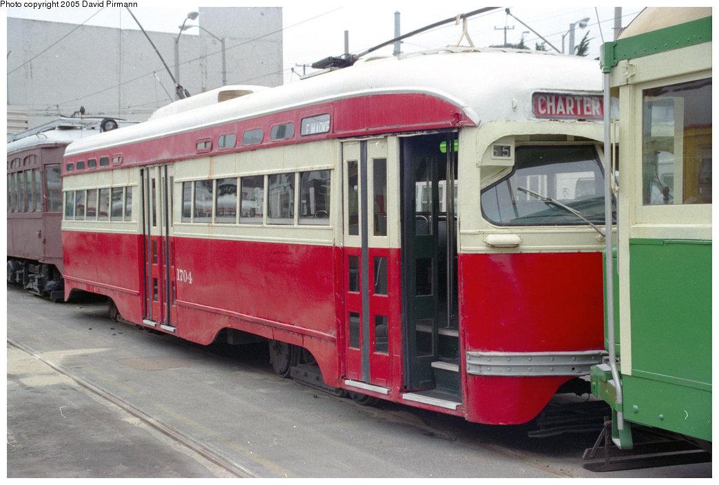 (184k, 1044x705)<br><b>Country:</b> United States<br><b>City:</b> San Francisco/Bay Area, CA<br><b>System:</b> SF MUNI<br><b>Location:</b> Geneva Yard <br><b>Car:</b> SF MUNI PCC St. Louis (St. Louis Car Co, 1946)  1704 (ex-1128)<br><b>Photo by:</b> David Pirmann<br><b>Date:</b> 7/7/1996<br><b>Viewed (this week/total):</b> 4 / 9031