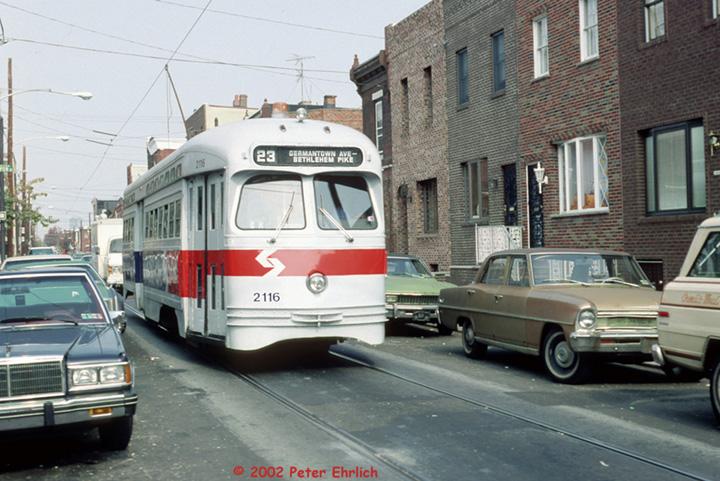 (157k, 720x481)<br><b>Country:</b> United States<br><b>City:</b> Philadelphia, PA<br><b>System:</b> SEPTA (or Predecessor)<br><b>Line:</b> Rt. 23-Germantown <br><b>Location:</b> 12th/Fizgerald <br><b>Route:</b> Rt 23<br><b>Car:</b> PTC/SEPTA Postwar All-electric PCC (St.Louis, 1948)  2116 <br><b>Photo by:</b> Peter Ehrlich<br><b>Date:</b> 10/20/1987<br><b>Notes:</b> 12th Street/Fitzgerald.  Route 23 southbound.<br><b>Viewed (this week/total):</b> 0 / 1404