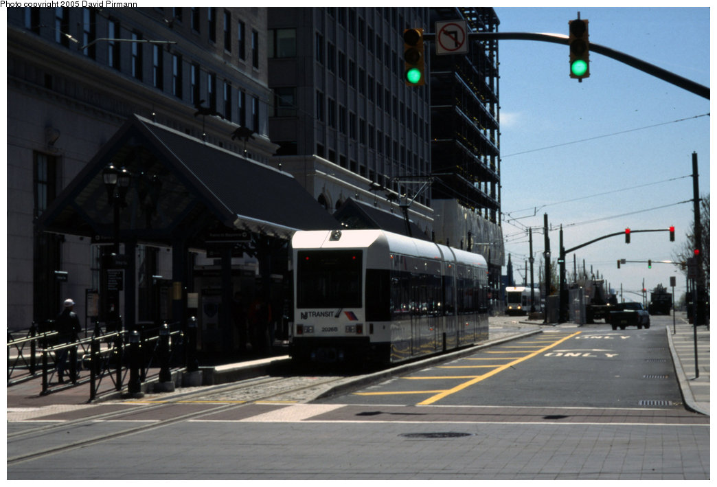 (156k, 1044x709)<br><b>Country:</b> United States<br><b>City:</b> Jersey City, NJ<br><b>System:</b> Hudson Bergen Light Rail<br><b>Location:</b> Exchange Place <br><b>Car:</b> NJT-HBLR LRV (Kinki-Sharyo, 1998-99)  2026 <br><b>Photo by:</b> David Pirmann<br><b>Date:</b> 4/29/2000<br><b>Viewed (this week/total):</b> 2 / 1475