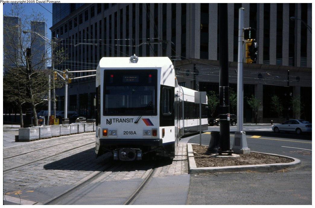 (184k, 1044x691)<br><b>Country:</b> United States<br><b>City:</b> Jersey City, NJ<br><b>System:</b> Hudson Bergen Light Rail<br><b>Location:</b> Exchange Place <br><b>Car:</b> NJT-HBLR LRV (Kinki-Sharyo, 1998-99)  2018 <br><b>Photo by:</b> David Pirmann<br><b>Date:</b> 4/29/2000<br><b>Viewed (this week/total):</b> 0 / 4906