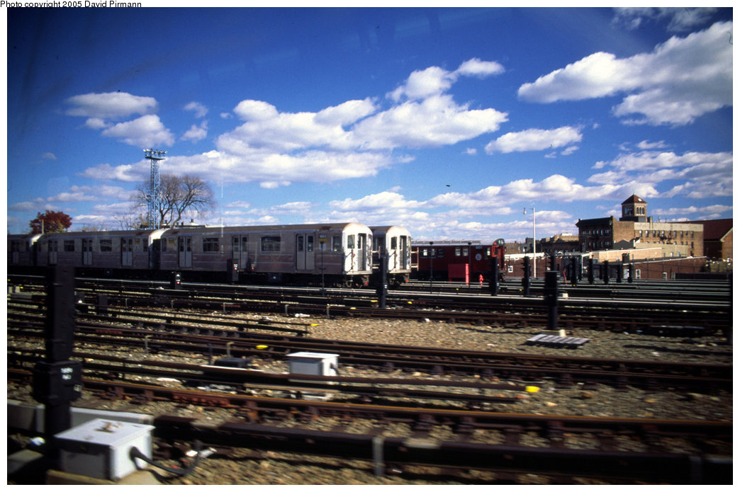 (201k, 1044x695)<br><b>Country:</b> United States<br><b>City:</b> New York<br><b>System:</b> New York City Transit<br><b>Location:</b> Unionport Yard<br><b>Car:</b> R-62A (Bombardier, 1984-1987)  1665 <br><b>Photo by:</b> David Pirmann<br><b>Date:</b> 12/5/1999<br><b>Notes:</b> With R33 8839<br><b>Viewed (this week/total):</b> 4 / 2683