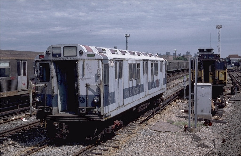 (213k, 1024x666)<br><b>Country:</b> United States<br><b>City:</b> New York<br><b>System:</b> New York City Transit<br><b>Location:</b> Coney Island Yard<br><b>Car:</b> R-12 (American Car & Foundry, 1948) W303 (ex-5756)<br><b>Photo by:</b> Steve Zabel<br><b>Collection of:</b> Joe Testagrose<br><b>Date:</b> 7/4/1982<br><b>Viewed (this week/total):</b> 2 / 2309