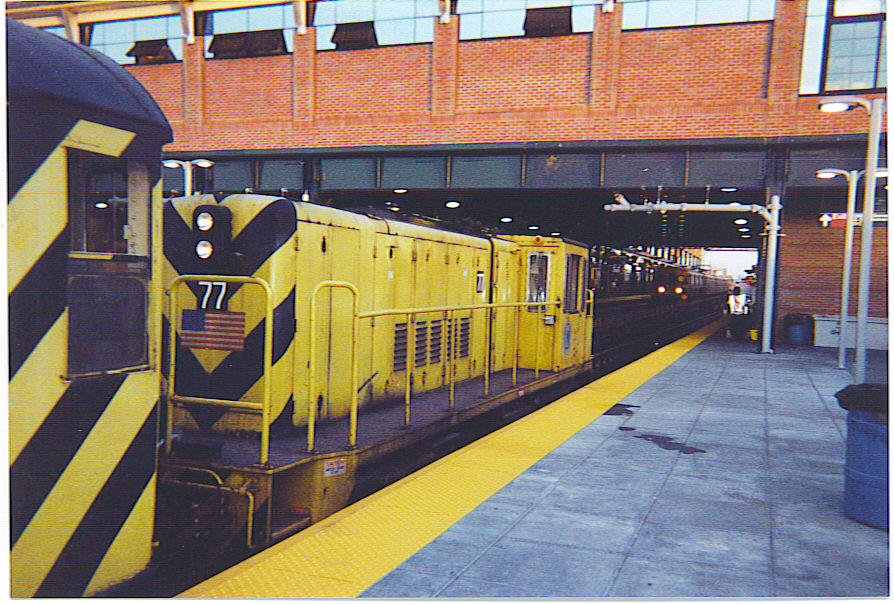 (175k, 894x604)<br><b>Country:</b> United States<br><b>City:</b> New York<br><b>System:</b> New York City Transit<br><b>Location:</b> Coney Island/Stillwell Avenue<br><b>Route:</b> Work Service<br><b>Car:</b> R-52 Locomotive  77 <br><b>Photo by:</b> Michael Hodurski<br><b>Date:</b> 6/7/2004<br><b>Viewed (this week/total):</b> 1 / 1629