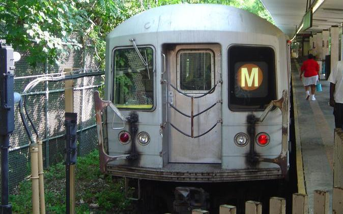 (70k, 674x422)<br><b>Country:</b> United States<br><b>City:</b> New York<br><b>System:</b> New York City Transit<br><b>Line:</b> BMT Myrtle Avenue Line<br><b>Location:</b> Metropolitan Avenue <br><b>Route:</b> M<br><b>Car:</b> R-42 (St. Louis, 1969-1970)   <br><b>Photo by:</b> Phillip Lee<br><b>Date:</b> 8/2/2005<br><b>Viewed (this week/total):</b> 0 / 2909