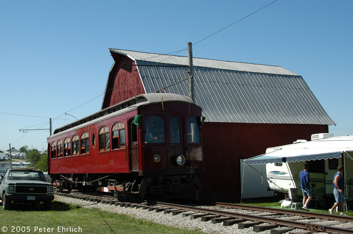 (136k, 720x478)<br><b>Country:</b> United States<br><b>City:</b> Mt. Pleasant, IA<br><b>System:</b> Midwest Old Threshers Museum <br><b>Location:</b> Midwest Threshers Museum -- Grandpa's Barn<br><b>Car:</b>  320 <br><b>Photo by:</b> Peter Ehrlich<br><b>Date:</b> 9/1/2005<br><b>Notes:</b> #320; Passing Grandpa's Barn, enroute to Depot discharge stop.<br><b>Viewed (this week/total):</b> 1 / 1208