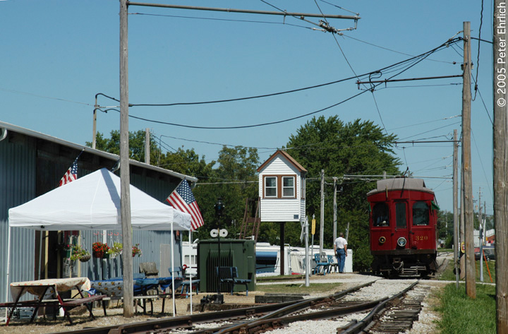 (154k, 720x473)<br><b>Country:</b> United States<br><b>City:</b> Mt. Pleasant, IA<br><b>System:</b> Midwest Old Threshers Museum <br><b>Location:</b> Midwest Threshers Museum -- Trolley Barn<br><b>Car:</b>  320 <br><b>Photo by:</b> Peter Ehrlich<br><b>Date:</b> 9/1/2005<br><b>Notes:</b> CA&E 320 at Trolley Barn stop.<br><b>Viewed (this week/total):</b> 0 / 1130