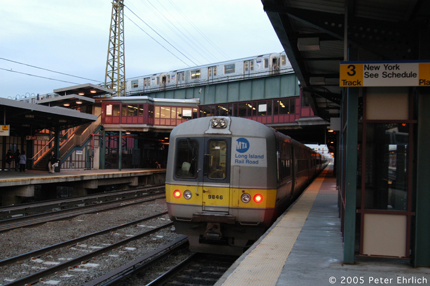 (194k, 864x574)<br><b>Country:</b> United States<br><b>City:</b> New York<br><b>System:</b> New York City Transit<br><b>Line:</b> IRT Flushing Line<br><b>Location:</b> 61st Street/Woodside <br><b>Route:</b> 7<br><b>Car:</b> R-62A (Bombardier, 1984-1987)  1938 <br><b>Photo by:</b> Peter Ehrlich<br><b>Date:</b> 12/19/2005<br><b>Notes:</b> With LIRR 9846.<br><b>Viewed (this week/total):</b> 1 / 3101