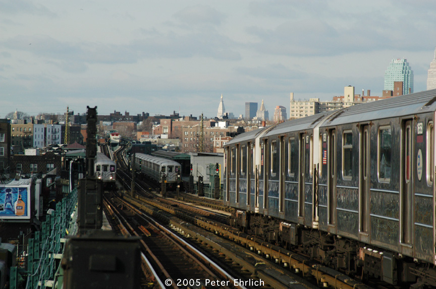 (193k, 864x574)<br><b>Country:</b> United States<br><b>City:</b> New York<br><b>System:</b> New York City Transit<br><b>Line:</b> IRT Flushing Line<br><b>Location:</b> 74th Street/Broadway <br><b>Route:</b> 7<br><b>Car:</b> R-62A (Bombardier, 1984-1987)  1656 <br><b>Photo by:</b> Peter Ehrlich<br><b>Date:</b> 12/30/2005<br><b>Notes:</b> 1656 at 74th/Broadway, plus two trains at 69th Street/Fisk Avenue Station.<br><b>Viewed (this week/total):</b> 1 / 1960