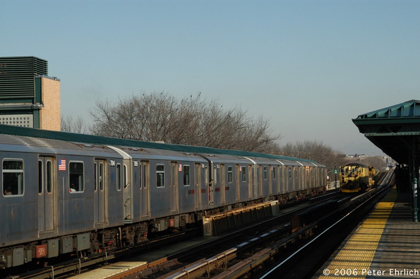 (167k, 864x574)<br><b>Country:</b> United States<br><b>City:</b> New York<br><b>System:</b> New York City Transit<br><b>Line:</b> IRT Woodlawn Line<br><b>Location:</b> 161st Street/River Avenue (Yankee Stadium) <br><b>Car:</b> R-142 (Option Order, Bombardier, 2002-2003)  7095 <br><b>Photo by:</b> Peter Ehrlich<br><b>Date:</b> 1/24/2006<br><b>Notes:</b> With work train W53.<br><b>Viewed (this week/total):</b> 4 / 2607