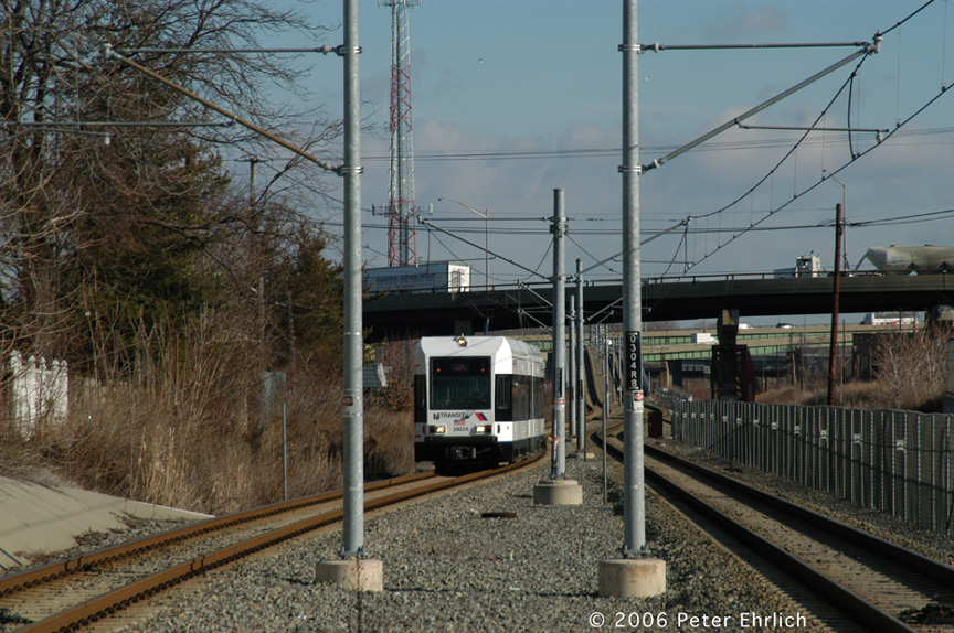 (248k, 864x574)<br><b>Country:</b> United States<br><b>City:</b> Bayonne, NJ<br><b>System:</b> Hudson Bergen Light Rail<br><b>Location:</b> East 45th Street <br><b>Car:</b> NJT-HBLR LRV (Kinki-Sharyo, 1998-99)  2003 <br><b>Photo by:</b> Peter Ehrlich<br><b>Date:</b> 1/25/2006<br><b>Viewed (this week/total):</b> 2 / 1369