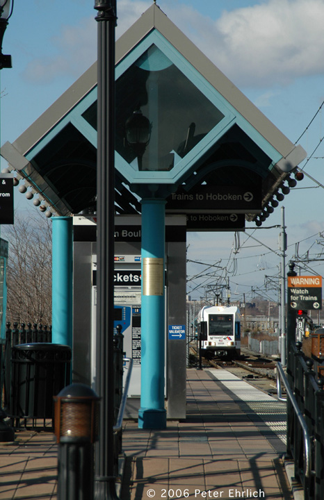 (141k, 466x720)<br><b>Country:</b> United States<br><b>City:</b> Jersey City, NJ<br><b>System:</b> Hudson Bergen Light Rail<br><b>Location:</b> Marin Boulevard <br><b>Car:</b> NJT-HBLR LRV (Kinki-Sharyo, 1998-99)  2023 <br><b>Photo by:</b> Peter Ehrlich<br><b>Date:</b> 1/25/2006<br><b>Viewed (this week/total):</b> 0 / 1372