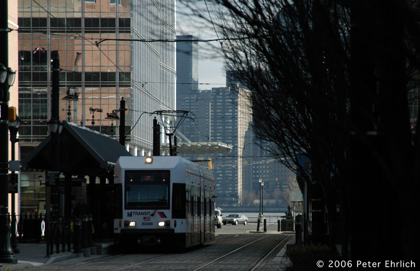 (181k, 864x557)<br><b>Country:</b> United States<br><b>City:</b> Jersey City, NJ<br><b>System:</b> Hudson Bergen Light Rail<br><b>Location:</b> Essex Street <br><b>Car:</b> NJT-HBLR LRV (Kinki-Sharyo, 1998-99)  2028 <br><b>Photo by:</b> Peter Ehrlich<br><b>Date:</b> 1/25/2006<br><b>Viewed (this week/total):</b> 0 / 1380