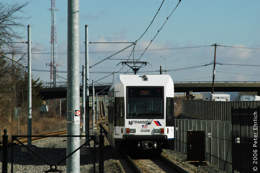 (210k, 864x574)<br><b>Country:</b> United States<br><b>City:</b> Bayonne, NJ<br><b>System:</b> Hudson Bergen Light Rail<br><b>Location:</b> East 45th Street <br><b>Car:</b> NJT-HBLR LRV (Kinki-Sharyo, 1998-99)  2028 <br><b>Photo by:</b> Peter Ehrlich<br><b>Date:</b> 1/25/2006<br><b>Viewed (this week/total):</b> 0 / 1345
