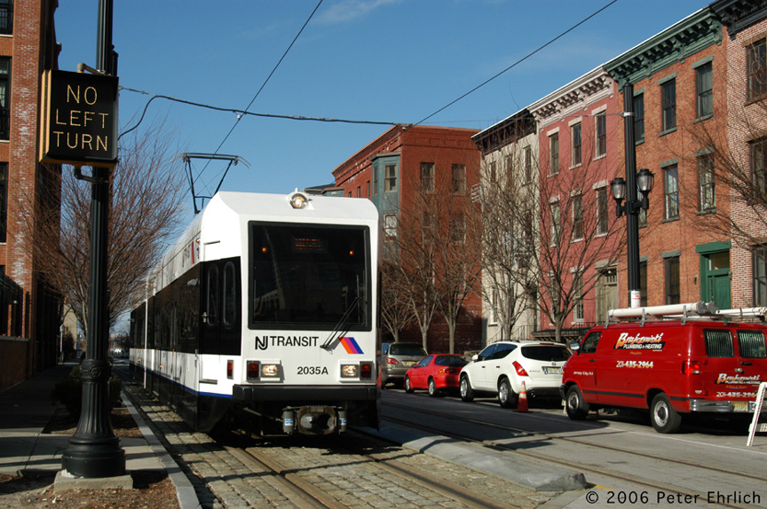 (249k, 864x574)<br><b>Country:</b> United States<br><b>City:</b> Jersey City, NJ<br><b>System:</b> Hudson Bergen Light Rail<br><b>Location:</b> Along Essex Street <br><b>Car:</b> NJT-HBLR LRV (Kinki-Sharyo, 1998-99)  2035 <br><b>Photo by:</b> Peter Ehrlich<br><b>Date:</b> 1/25/2006<br><b>Notes:</b> Essex/Washington Streets inbound.<br><b>Viewed (this week/total):</b> 0 / 1227