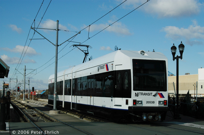 (163k, 864x574)<br><b>Country:</b> United States<br><b>City:</b> Jersey City, NJ<br><b>System:</b> Hudson Bergen Light Rail<br><b>Location:</b> Marin Boulevard <br><b>Car:</b> NJT-HBLR LRV (Kinki-Sharyo, 1998-99)  2053 <br><b>Photo by:</b> Peter Ehrlich<br><b>Date:</b> 1/25/2006<br><b>Notes:</b> This car (2053) is part of the new order which went into service in 2005.<br><b>Viewed (this week/total):</b> 0 / 1250