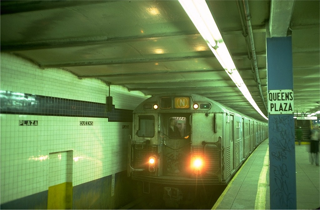 (163k, 1024x673)<br><b>Country:</b> United States<br><b>City:</b> New York<br><b>System:</b> New York City Transit<br><b>Line:</b> IND Queens Boulevard Line<br><b>Location:</b> Queens Plaza <br><b>Route:</b> N<br><b>Car:</b> R-38 (St. Louis, 1966-1967)  4008 <br><b>Photo by:</b> Doug Grotjahn<br><b>Collection of:</b> Joe Testagrose<br><b>Date:</b> 12/14/1976<br><b>Viewed (this week/total):</b> 1 / 4307