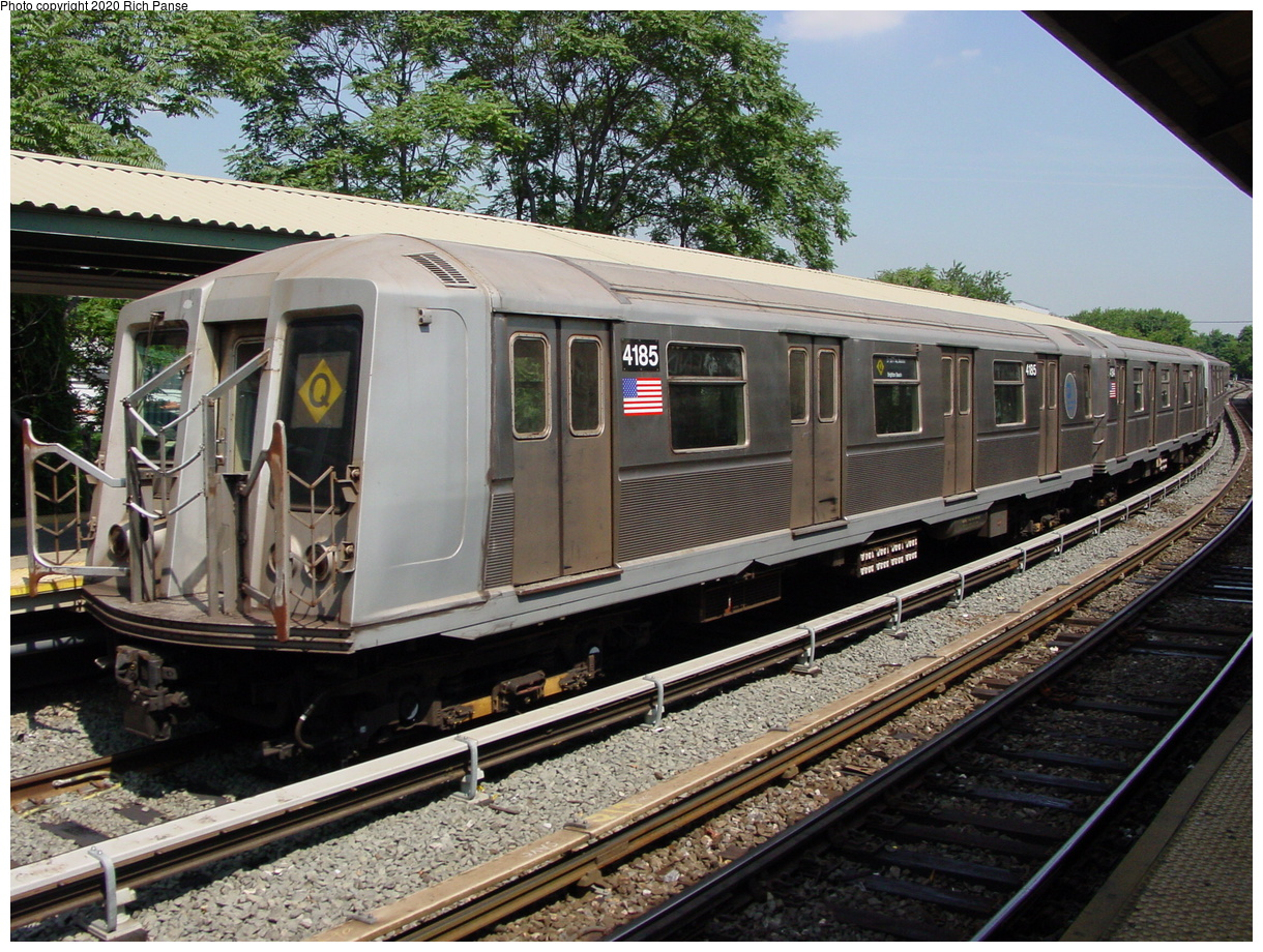 (113k, 820x620)<br><b>Country:</b> United States<br><b>City:</b> New York<br><b>System:</b> New York City Transit<br><b>Line:</b> BMT Brighton Line<br><b>Location:</b> Sheepshead Bay <br><b>Route:</b> Q<br><b>Car:</b> R-40 (St. Louis, 1968)  4185 <br><b>Photo by:</b> Richard Panse<br><b>Date:</b> 8/1/2002<br><b>Viewed (this week/total):</b> 0 / 11814