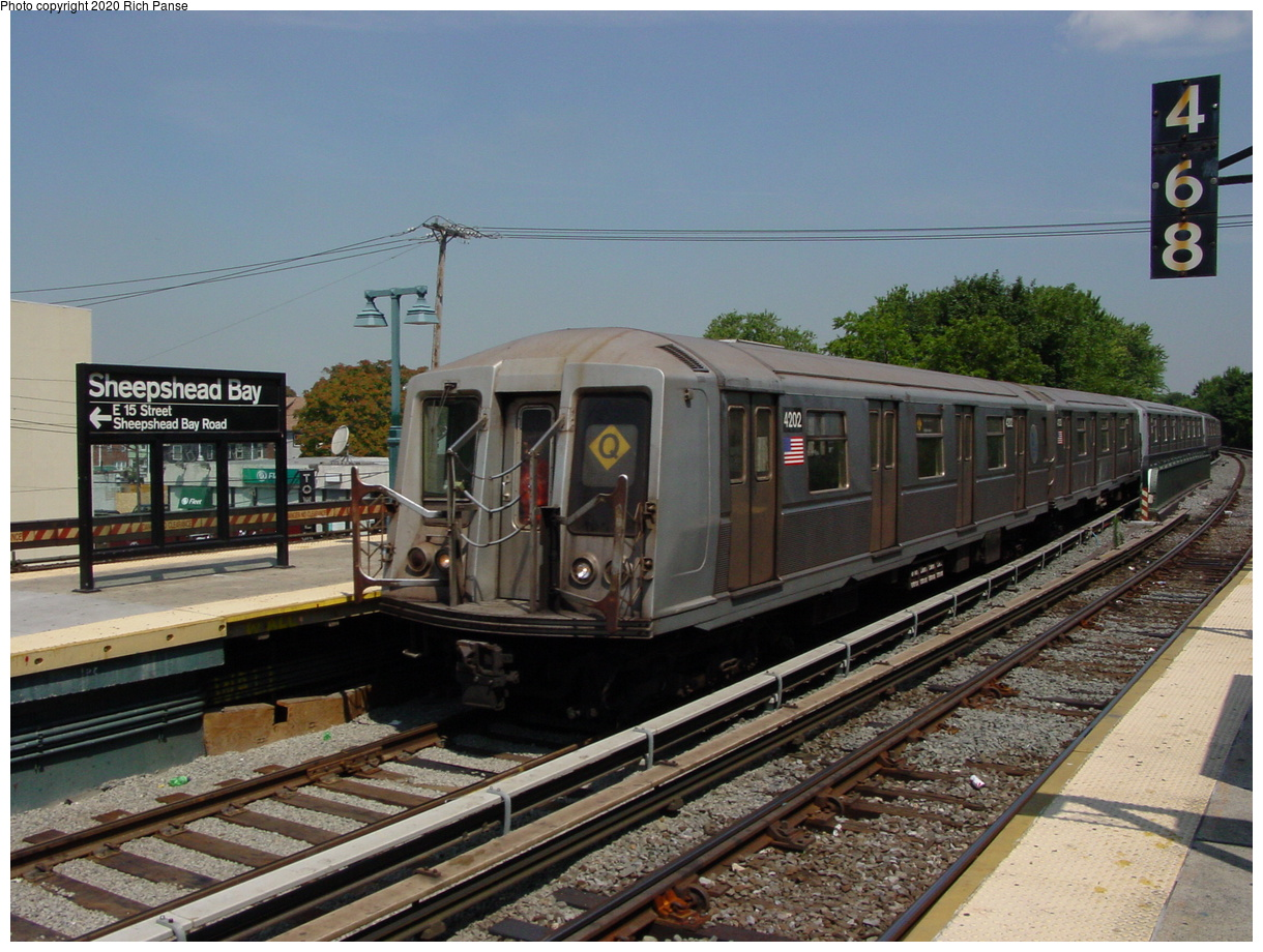 (84k, 820x620)<br><b>Country:</b> United States<br><b>City:</b> New York<br><b>System:</b> New York City Transit<br><b>Line:</b> BMT Brighton Line<br><b>Location:</b> Sheepshead Bay <br><b>Route:</b> Q<br><b>Car:</b> R-40 (St. Louis, 1968)  4202 <br><b>Photo by:</b> Richard Panse<br><b>Date:</b> 8/1/2002<br><b>Viewed (this week/total):</b> 5 / 3357