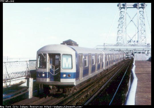 (38k, 540x379)<br><b>Country:</b> United States<br><b>City:</b> New York<br><b>System:</b> New York City Transit<br><b>Line:</b> BMT Nassau Street/Jamaica Line<br><b>Location:</b> Williamsburg Bridge<br><b>Route:</b> M<br><b>Car:</b> R-42 (St. Louis, 1969-1970)   <br><b>Collection of:</b> Jason R. DeCesare<br><b>Date:</b> 1972<br><b>Viewed (this week/total):</b> 3 / 3821