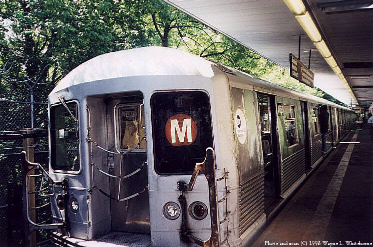 (122k, 745x495)<br><b>Country:</b> United States<br><b>City:</b> New York<br><b>System:</b> New York City Transit<br><b>Line:</b> BMT Myrtle Avenue Line<br><b>Location:</b> Metropolitan Avenue <br><b>Route:</b> M<br><b>Car:</b> R-42 (St. Louis, 1969-1970)  4853 <br><b>Photo by:</b> Wayne Whitehorne<br><b>Date:</b> 1998<br><b>Viewed (this week/total):</b> 4 / 3948