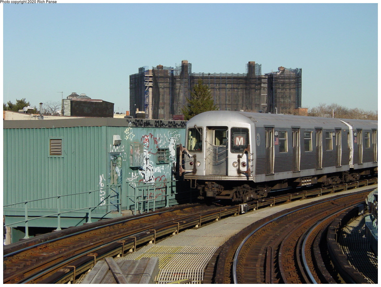 (83k, 820x620)<br><b>Country:</b> United States<br><b>City:</b> New York<br><b>System:</b> New York City Transit<br><b>Line:</b> BMT Myrtle Avenue Line<br><b>Location:</b> Seneca Avenue <br><b>Route:</b> M<br><b>Car:</b> R-42 (St. Louis, 1969-1970)  4874 <br><b>Photo by:</b> Richard Panse<br><b>Date:</b> 1/25/2002<br><b>Viewed (this week/total):</b> 4 / 3189