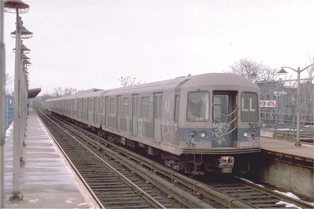 (184k, 1024x683)<br><b>Country:</b> United States<br><b>City:</b> New York<br><b>System:</b> New York City Transit<br><b>Line:</b> BMT Canarsie Line<br><b>Location:</b> New Lots Avenue <br><b>Route:</b> LL<br><b>Car:</b> R-42 (St. Louis, 1969-1970)  4876 <br><b>Photo by:</b> Ed McKernan<br><b>Collection of:</b> Joe Testagrose<br><b>Date:</b> 2/1976<br><b>Viewed (this week/total):</b> 3 / 2555